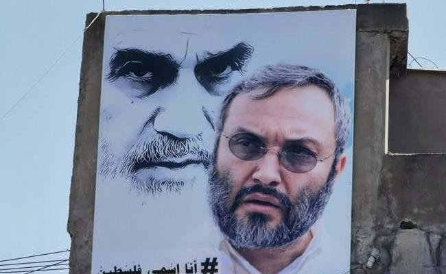 ifmat - Poster of Hezbollah commander with Ruhollah Khomeini in Nabatieh town