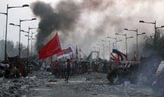 ifmat - Iraqi protestors target Tehran-backed militias