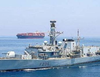 Iranian forces surround US containership in Strait of Hormuz