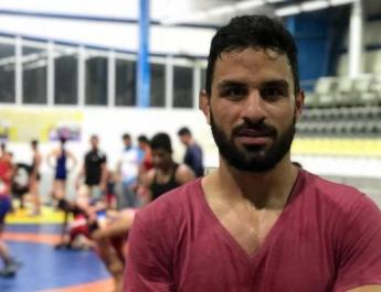 ifmat - Iran imposes double execution on champion wrestler for peacefully protesting regime
