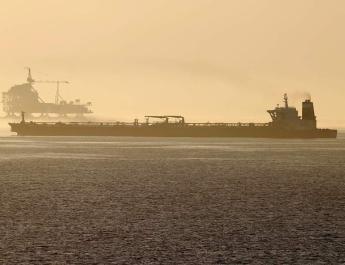 ifmat - US seeks to seize suspected Iranian oil aboard Greek-managed tanker