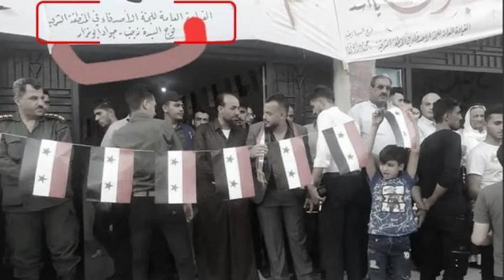 ifmat - Al-Duwayhi beneath a banner in support of Al-Assad's recent election campaign