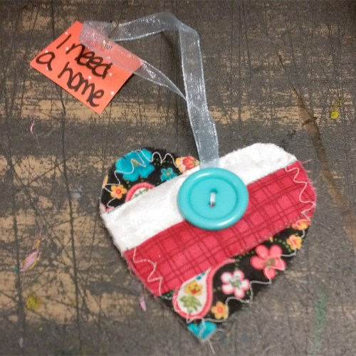 red white and teal button heart wx