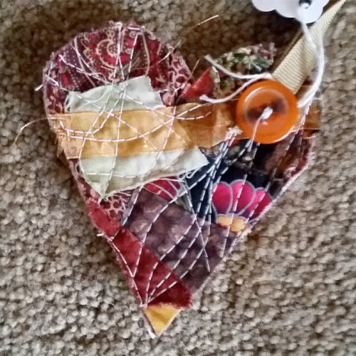 stitched heart with orange button  wx