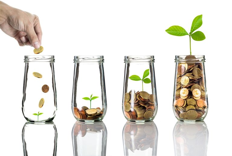 Hand into jar and coins - Independent Financial Planning – Stonehouse