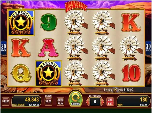 Play Rawhide slot machine at Star Play casino game symbols
