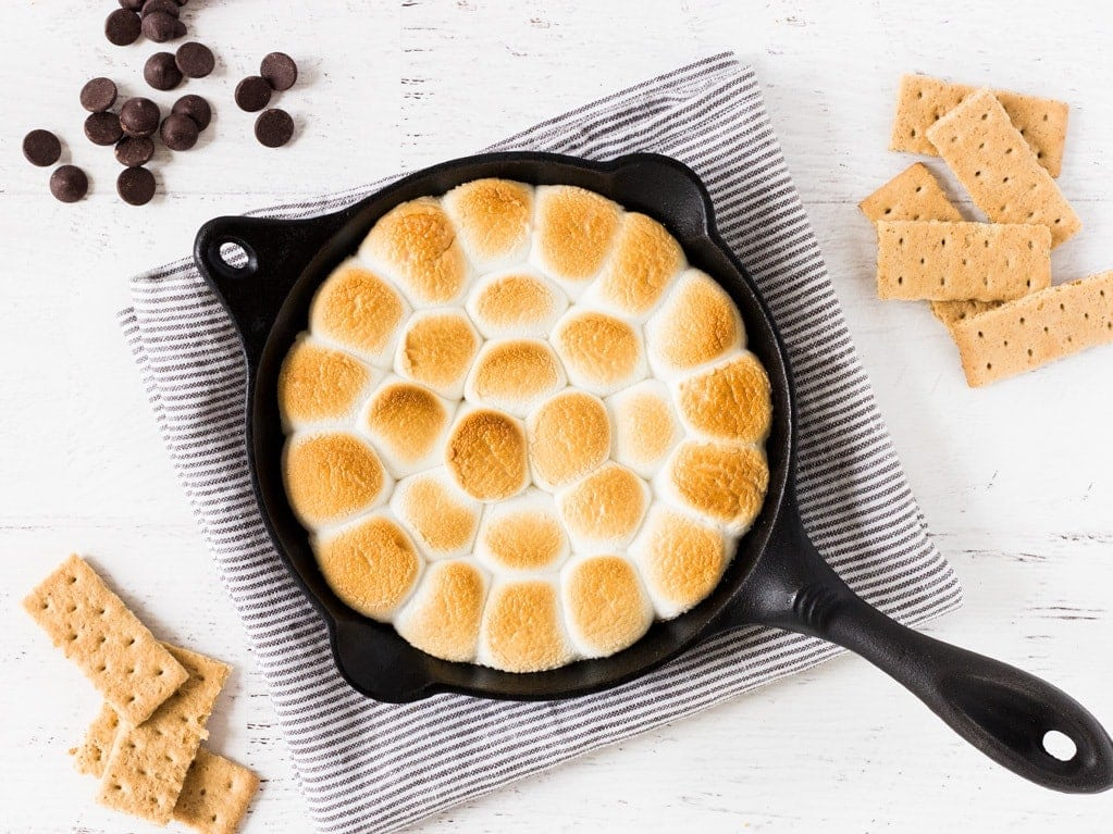 How to make smores dip with chocolate chips, marshmallows and graham crackers. | www.ifyougiveablondeakitchen.com