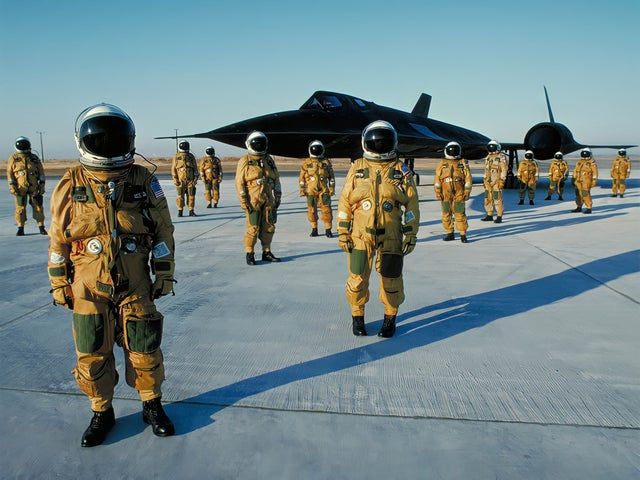Pilots stand in front of the SR-71 Blackbird