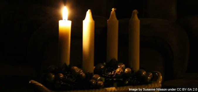 First Sunday of Advent candle lit - image by Susanne Nilsson (cropped) under CC BY-SA 2.0