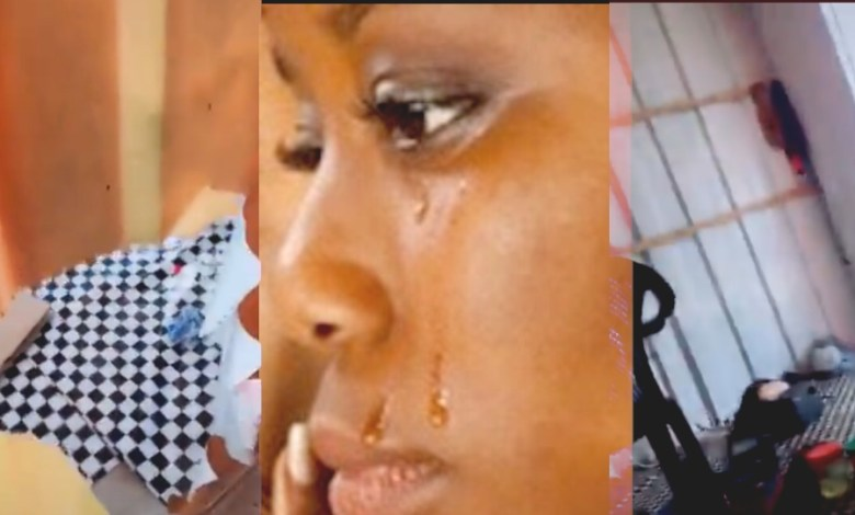 Lady cries as thieves cut through metal container to empty