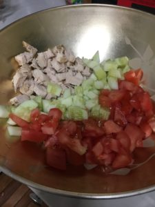 Cut up veggies for your pasta chicken cucumber salad