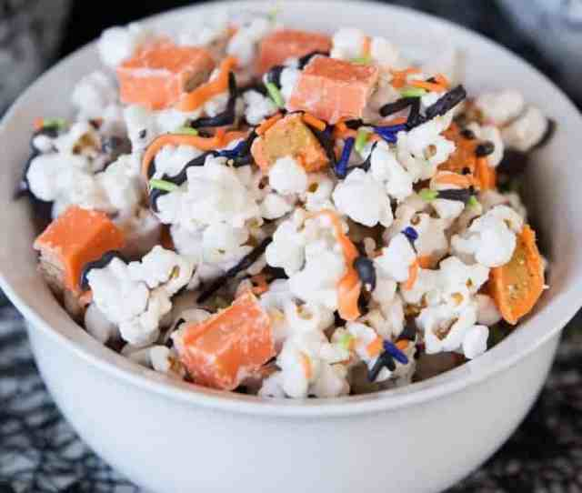 Halloween Candy Popcorn Covered In White Chocolate Mixed With Kit Kat Bars And Reeses So