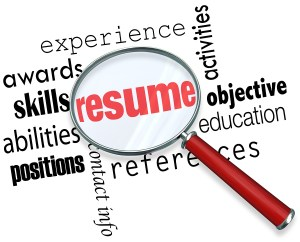 A magnifying glass over the word Resume surrounded by related te