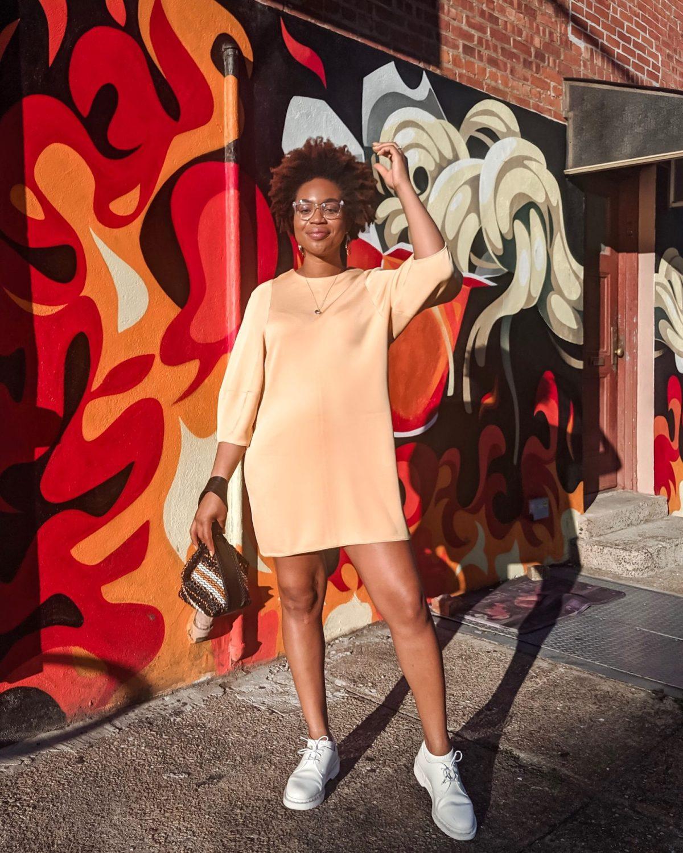 Ijeoma Kola wearing tibi balloon sleeve dress and white doc martens in Williamsburg, Brooklyn