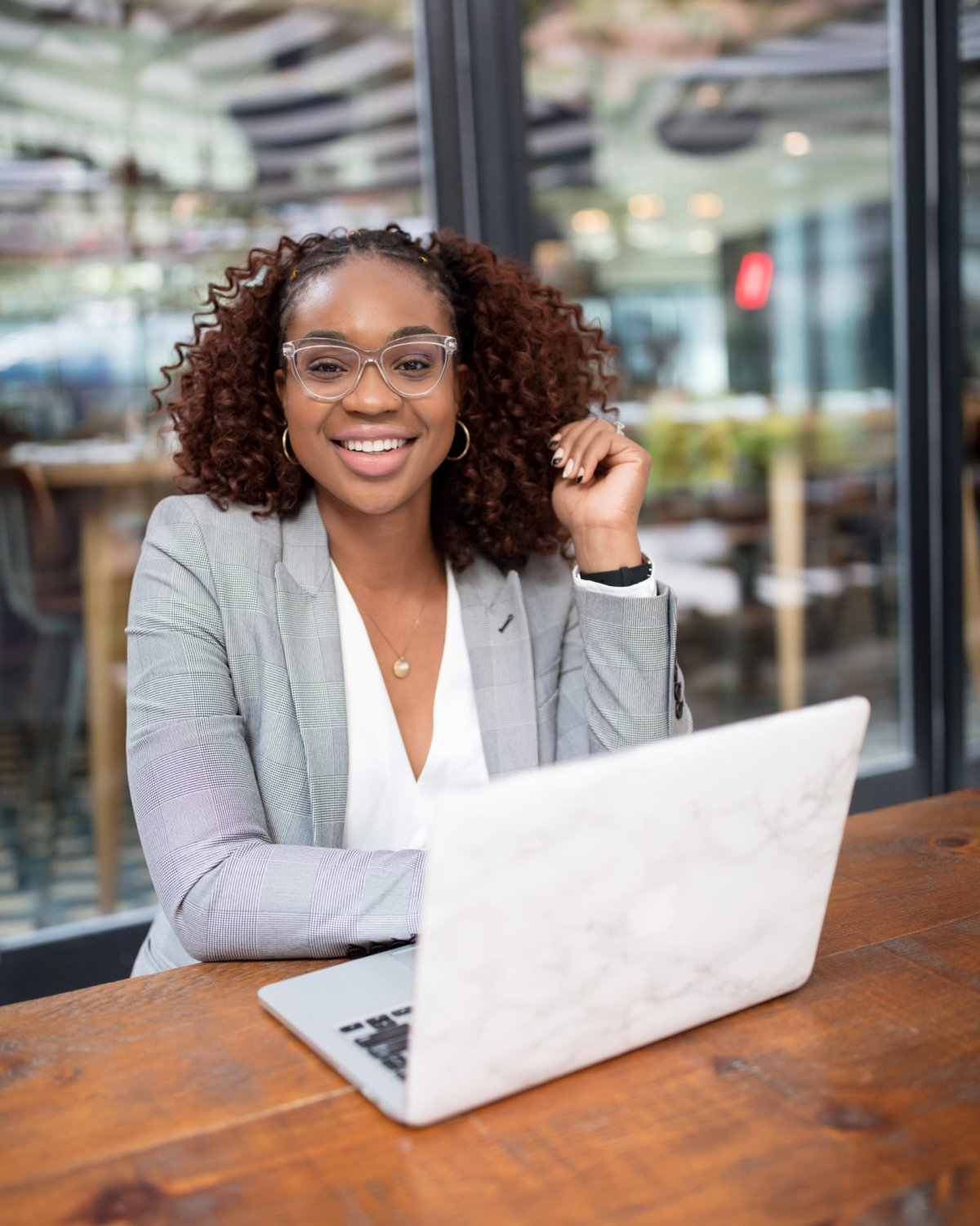 Ijeoma Kola in Signature Clear Framed Glasses with Laptop