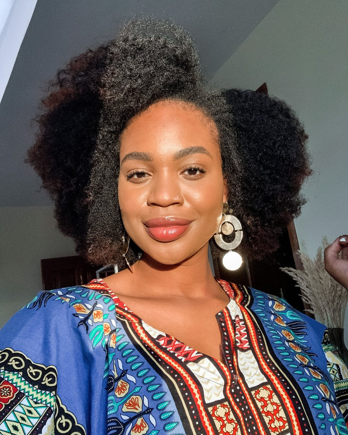 natural hair gold statement earrings and a dashiki