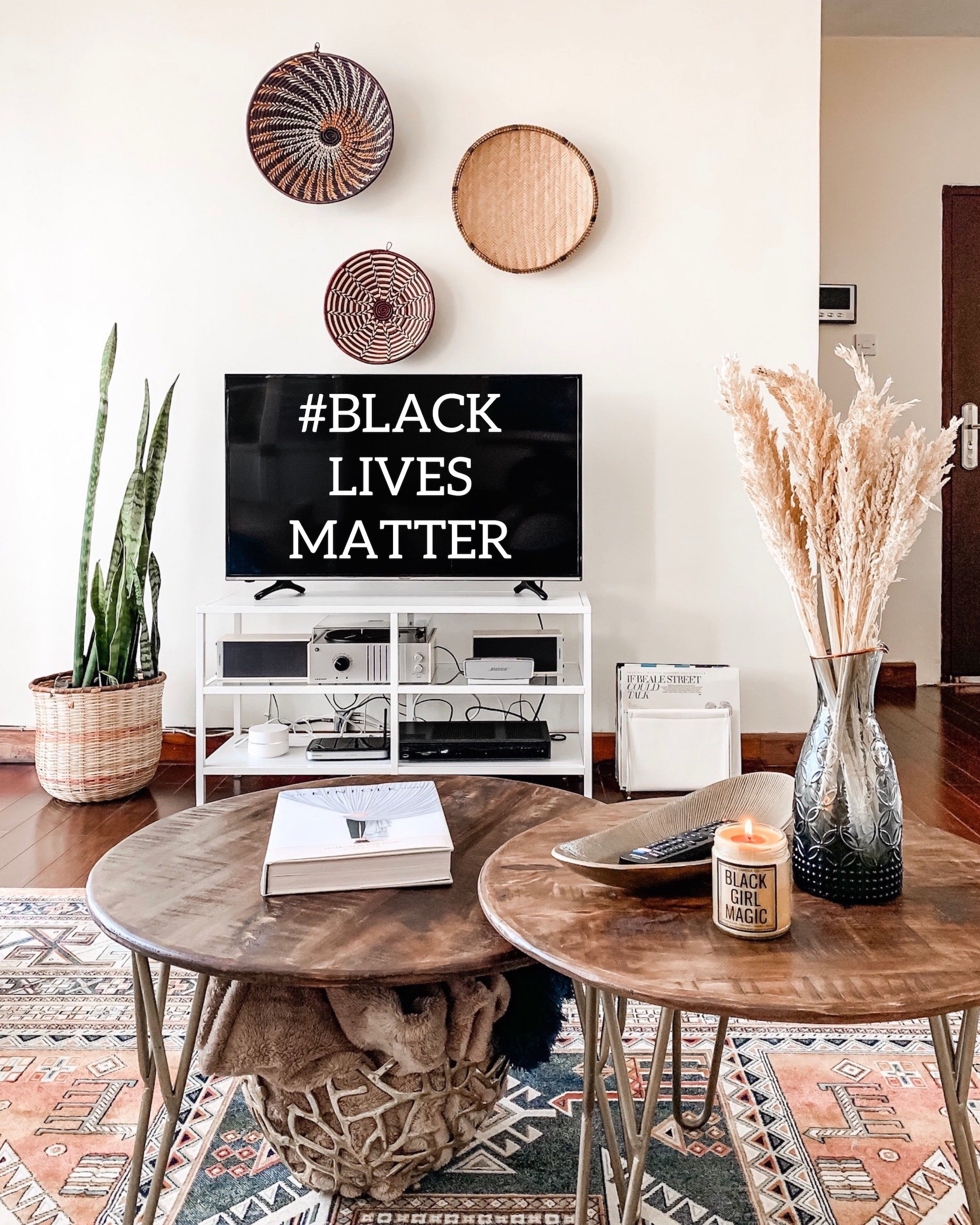 Living room set up with African inspired home decor and Black Lives Matter on TV screen