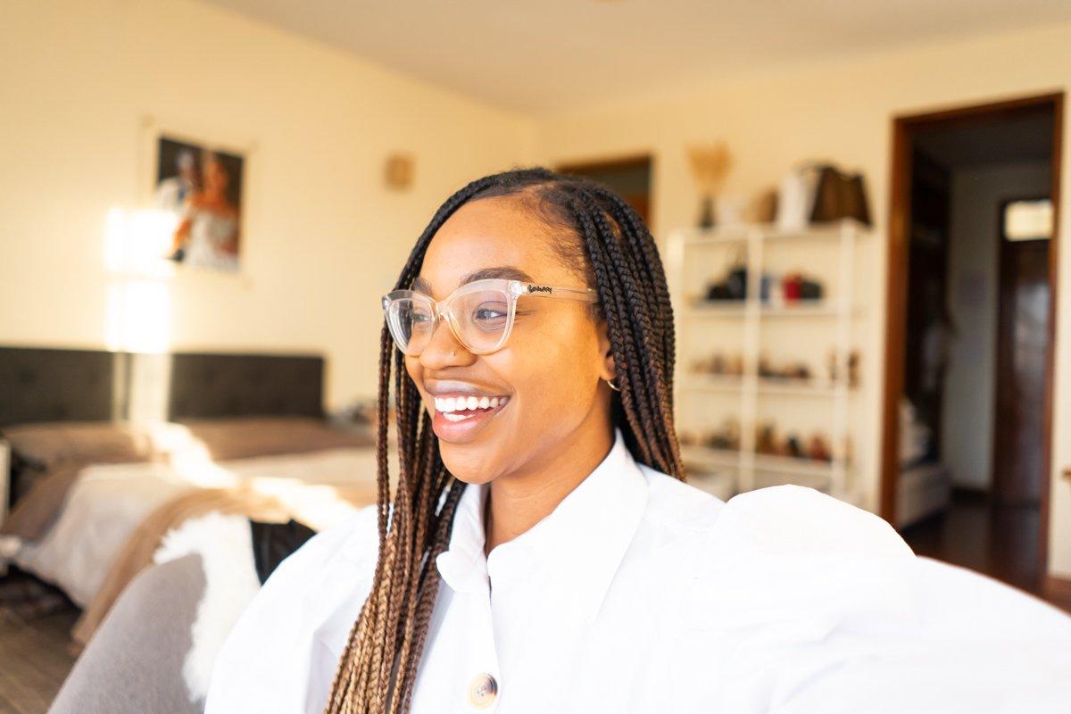 Ijeoma Kola Smiling in Transparent Glasses