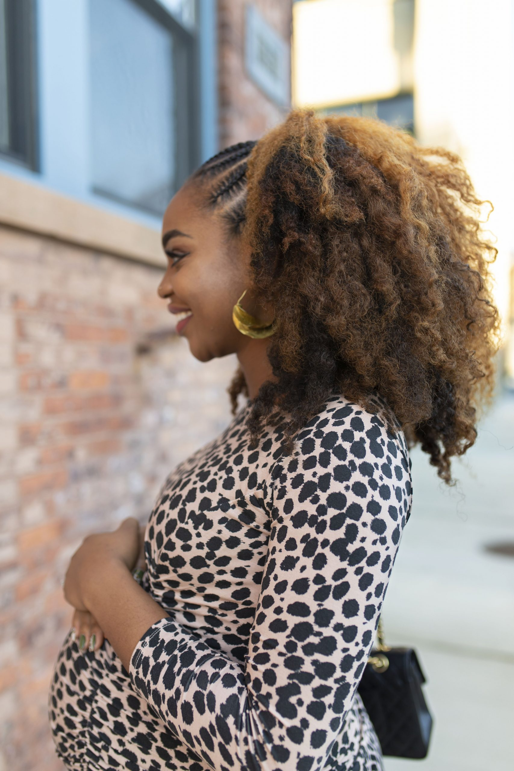 Ijeoma Kola pregnant in leopard print dress and stitch braids and curls natural hairstyle