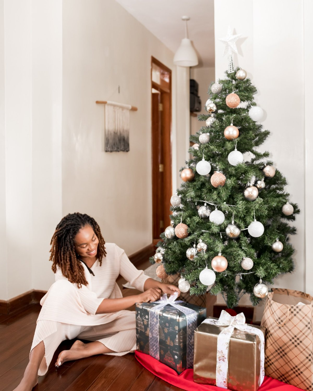 Ijeoma Kola opening Christmas gifts. The Ultimate Black Owned Holida Gift Guide.