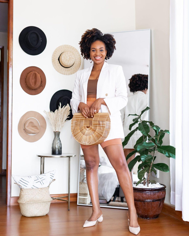 Ijeoma Kola in Black owned white blazer and shorts