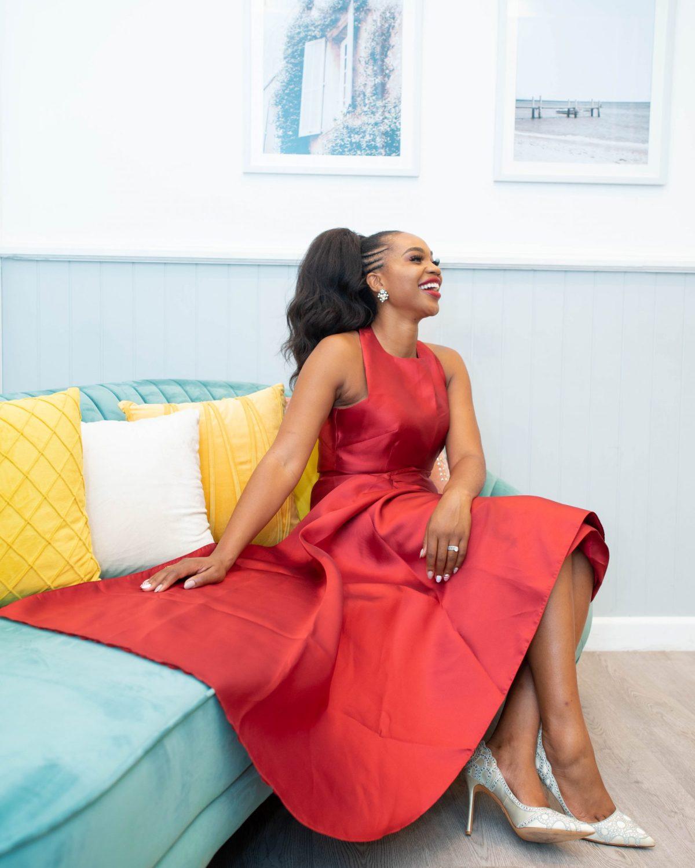 Ijeoma Kola in red dress