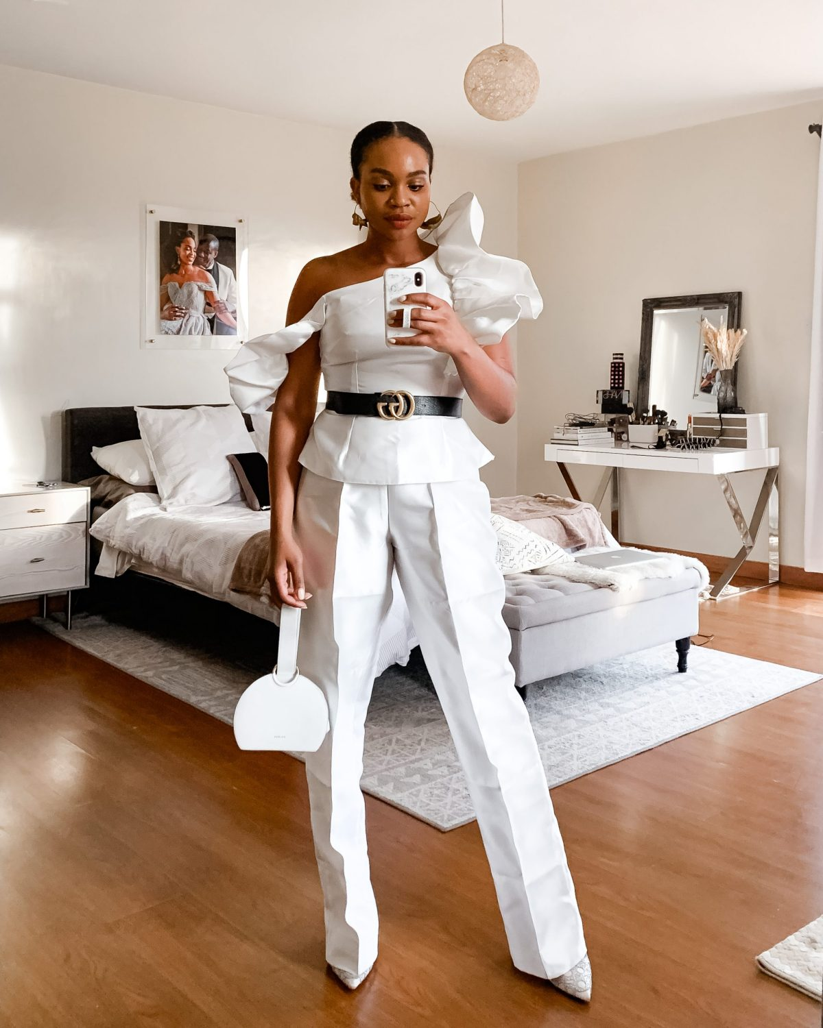 Ijeoma Kola in white outfit and black Gucci belt