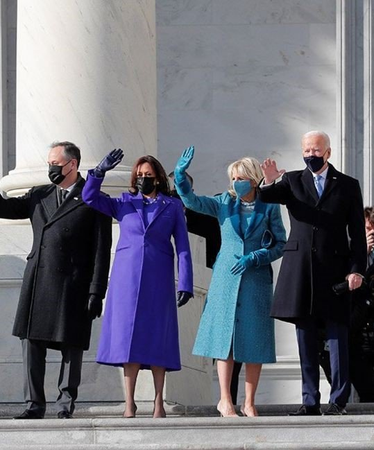 Biden-Harris waving at inauguration alongside their spouses