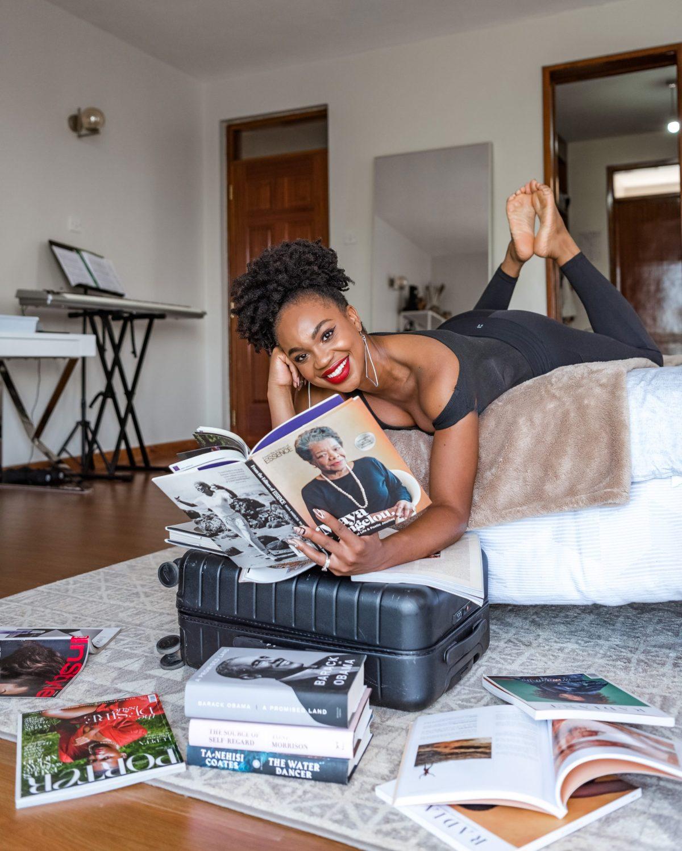 Ijeoma Kola reenacting pose of Maya Angelou reading