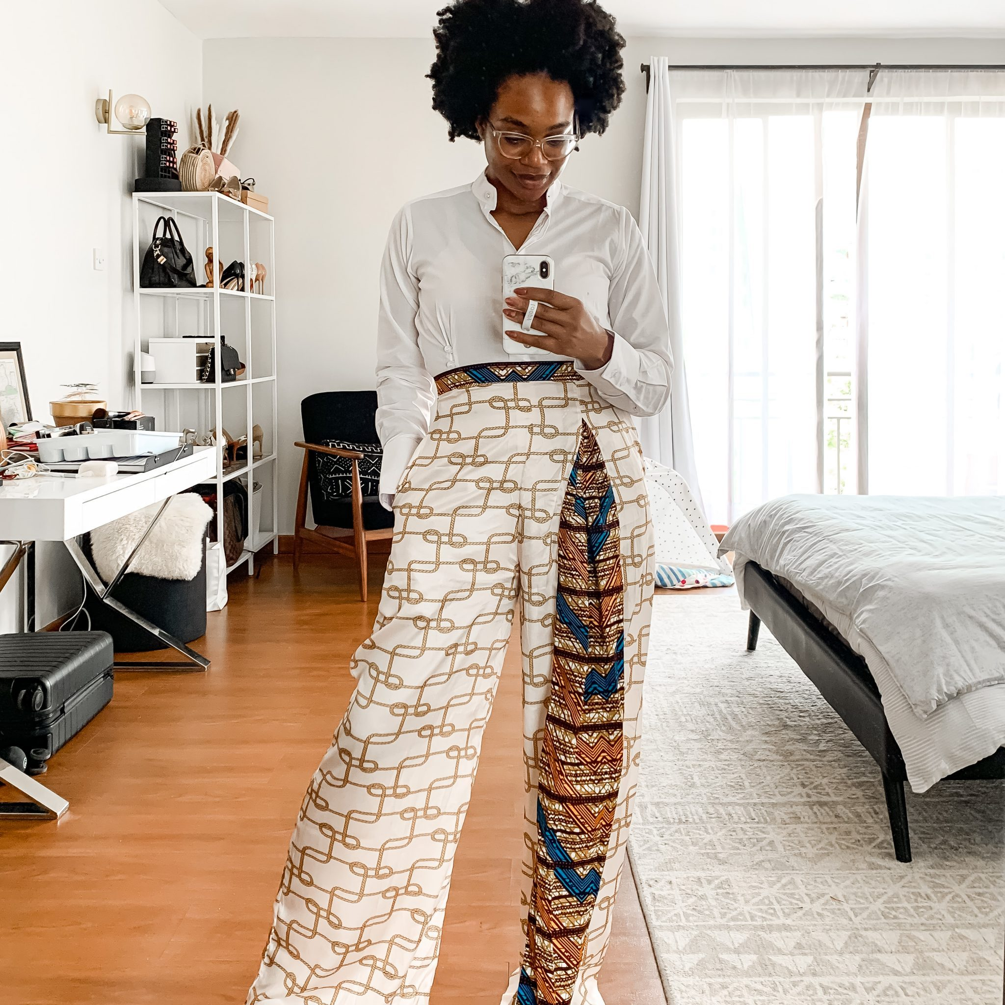 IJeoma. kola.posing in print pants and white shirt taking mirror selfie - Financial lessons blog