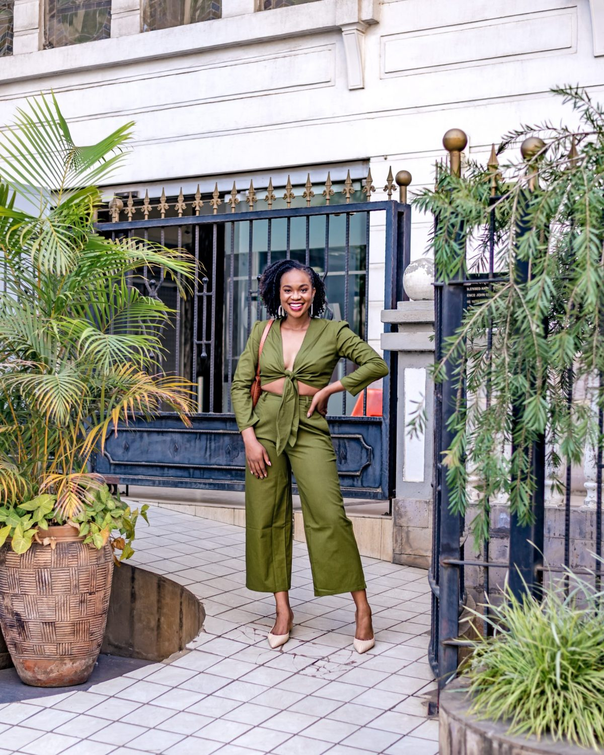 Ijeoma Kola in green two-piece set posing with hand on hip - Confidence Tips blog