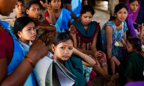Women gather to see a community health worker in Bhaishahi village, Bardiya, western Nepal, June 2012. Photograph: Suzanne Lee for the Guardian
