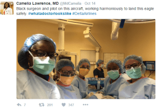 In this screenshot of a tweet by Camelia Lawrence, MD, we see six women scrubbed in and fully garbed in surgical gear. The patient is not visible (as is only correct).  Two of the women have dark brown skin. The hashtag is #whatadoctorlookslike.