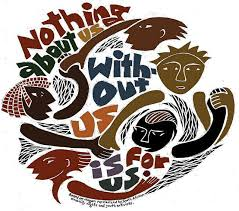 """This image shows heads and arms of different skintones interlocked in a circular formation, interspersed with the words """"Nothing about us without us is for us."""" Below the graphic in tiny font are the words """"Based on slogan popularized by South African disability rights and youth activists"""""""