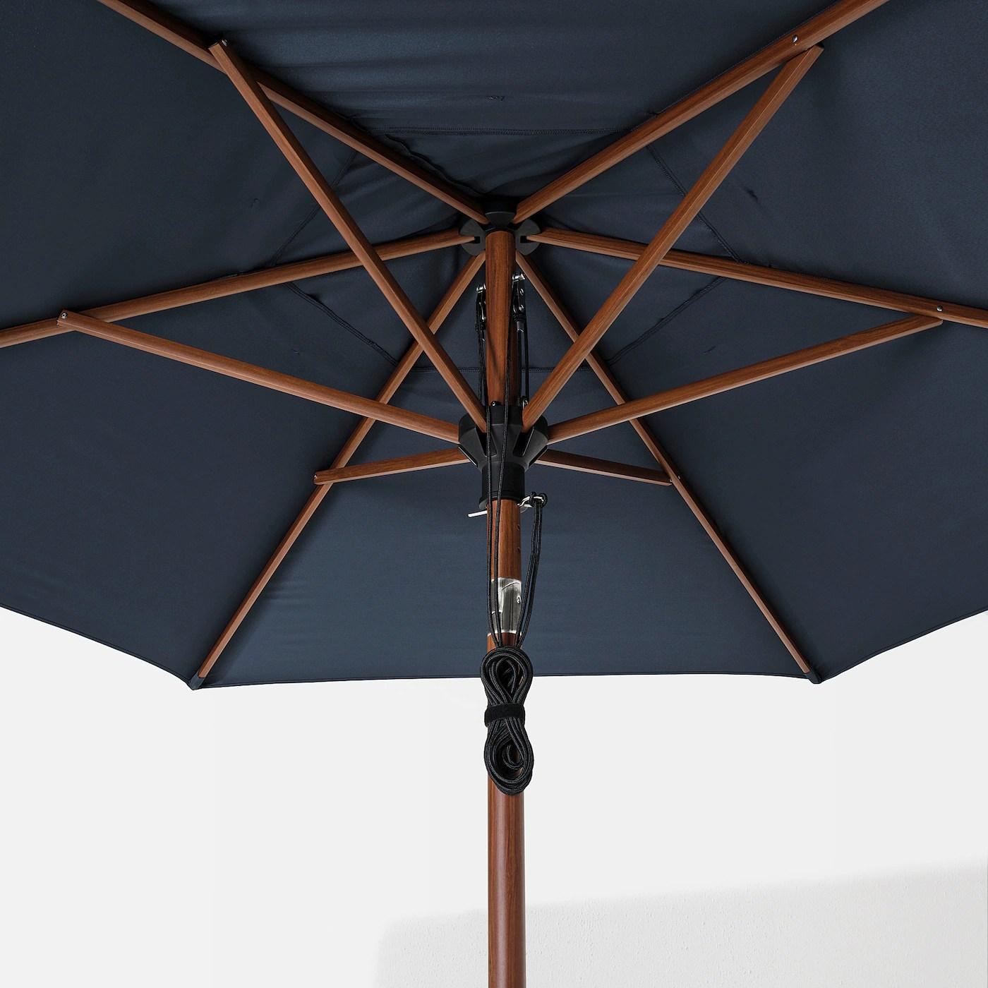 https www ikea com ca en p betsoe lindoeja patio umbrella brown wood effect dark blue s89324732