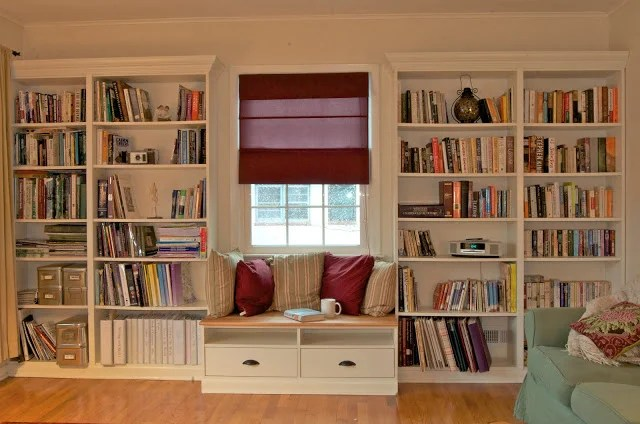 built in bookshelves with window seat