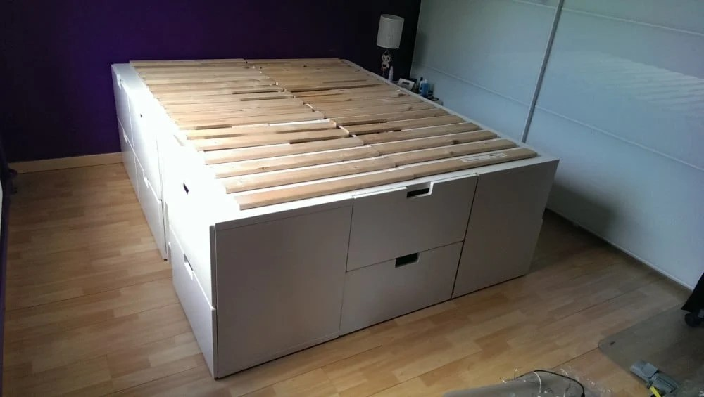 Make a storage bed frame from kitchen high cabinets