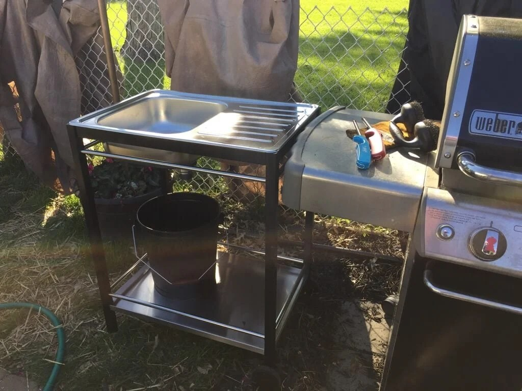 Attach outdoor sink to frame