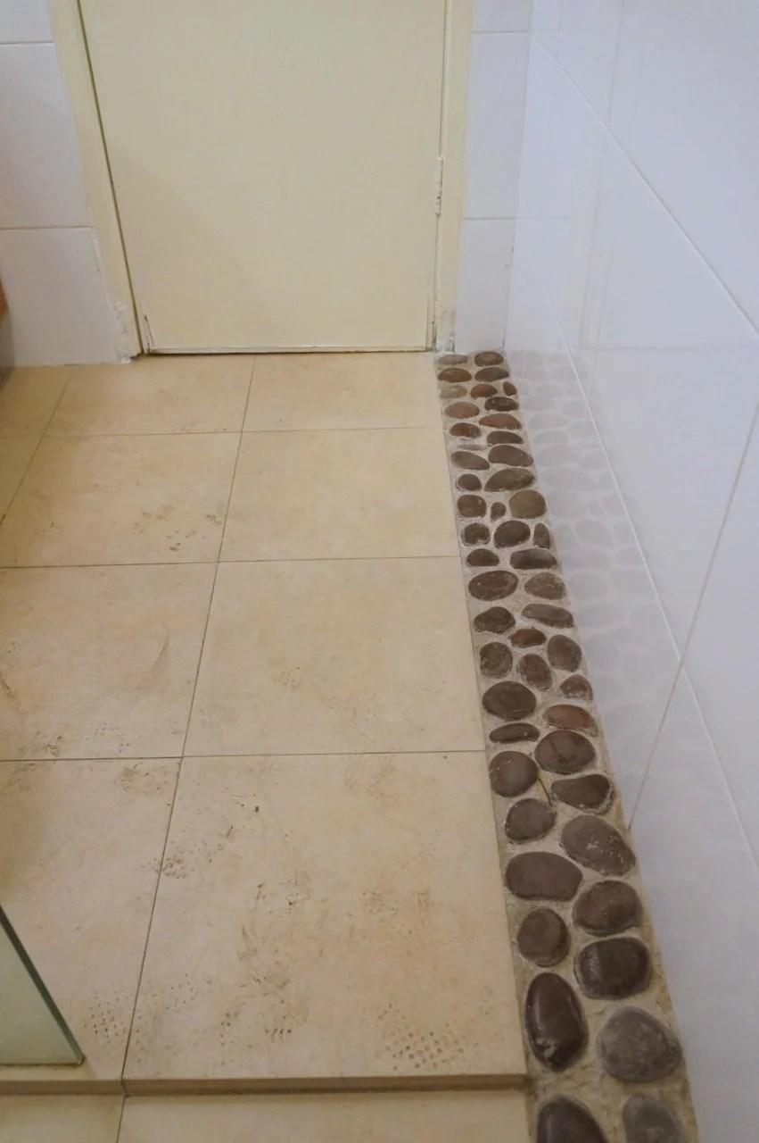house 17 bathroom tiles before