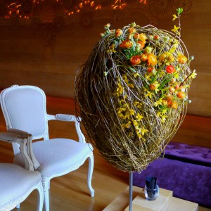 Seasonal Decorations - Easter. Golden Egg Ikebana installation by Ekaterina Seehaus IkebanaPro.com Materials: willow branches, ranunculus, flowaring forsythia branches.