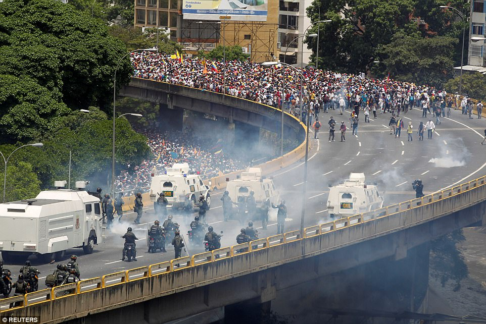 Protesters march in solidarity against despot Nicolas Maduro