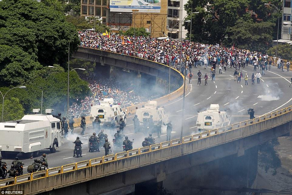 Protesters march in solidarity against despot Nicolas Maduro