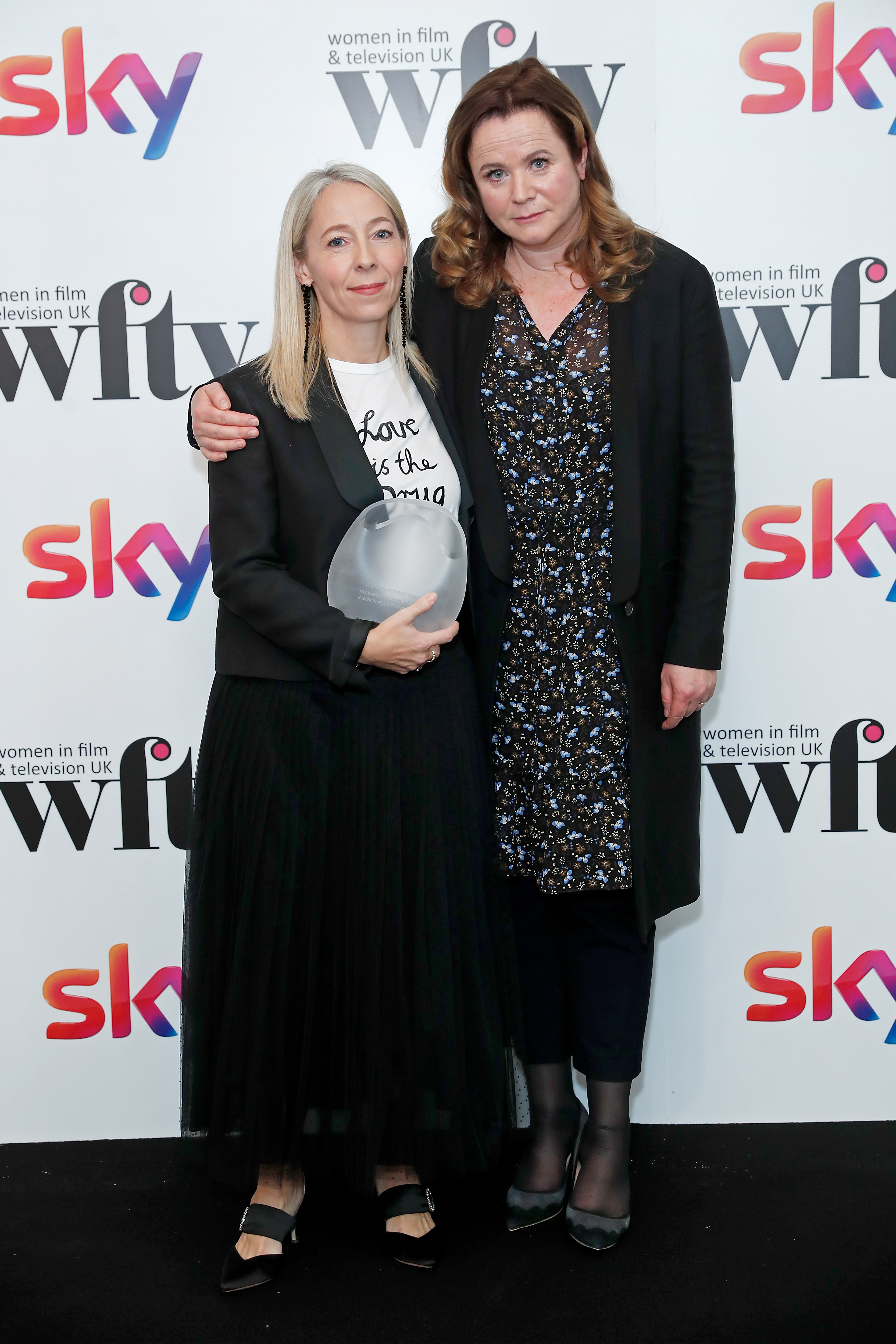 LONDON, ENGLAND - DECEMBER 06: Jane Featherston winner of the Barclays Business Award presented by Emily Watson in the winners room at the Women in Film and TV Awards 2019 at Hilton Park Lane on December 06, 2019 in London, England. (Photo by David M. Benett/Dave Benett/Getty Images for Women in Film and TV)