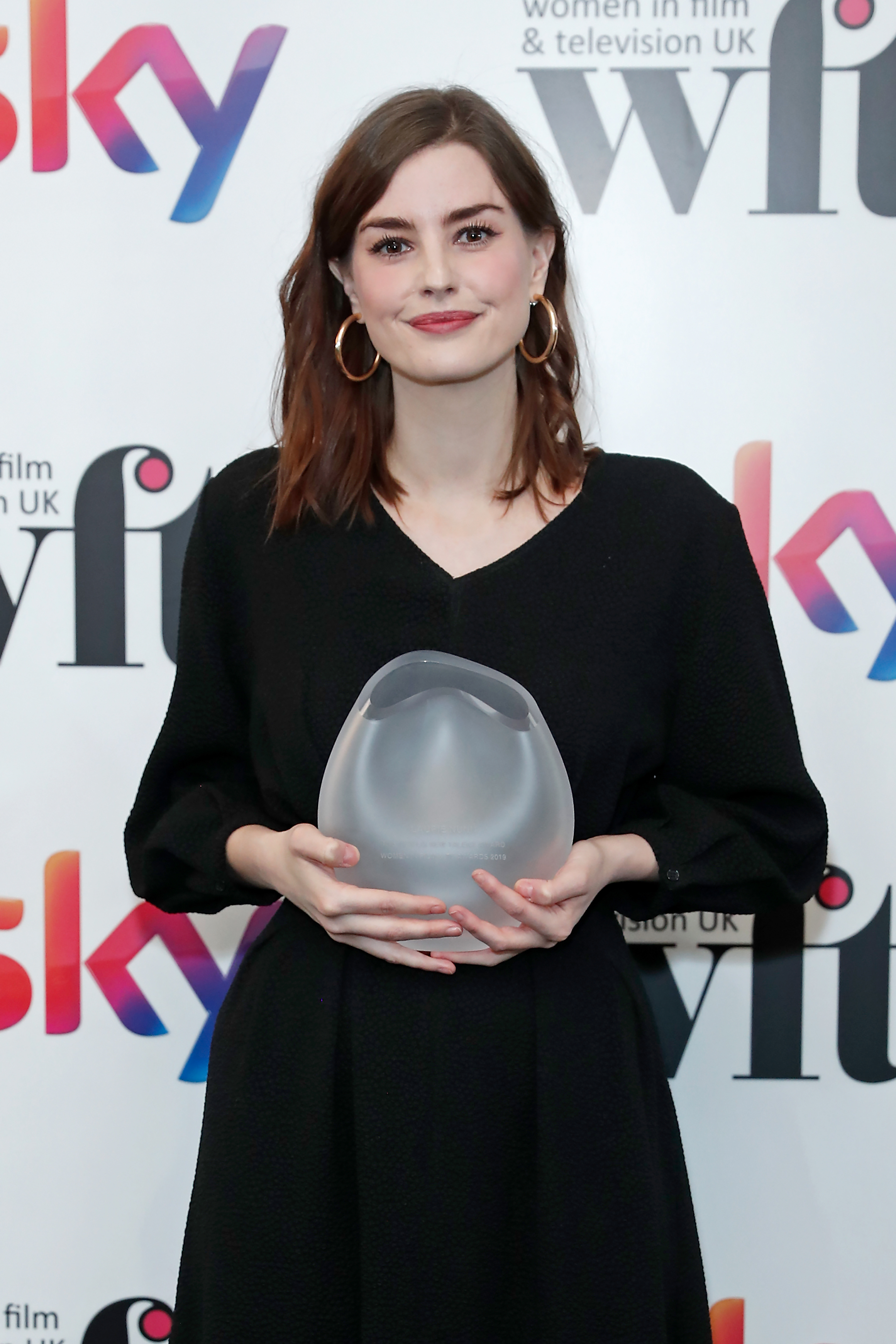 LONDON, ENGLAND - DECEMBER 06: Laurie Nunn Laurie Nunn winner of the Netflix New Talent Award in the winners room at the Women in Film and TV Awards 2019 at Hilton Park Lane on December 06, 2019 in London, England. (Photo by David M. Benett/Dave Benett/Getty Images for Women in Film and TV)