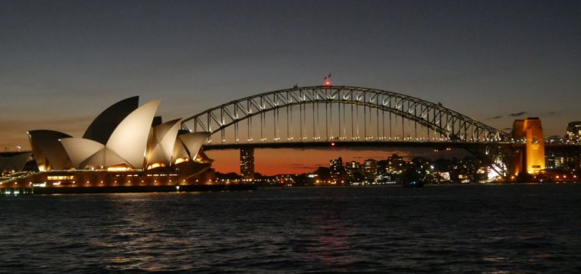 Sunset with Harbour Bridge and Opera House while the lights are starting to burn