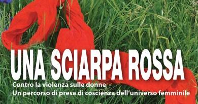 Una sciarpa rossa contro la violenza sulle donne