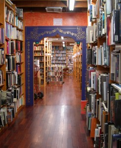 The main aisle between rooms at the Iliad Bookshop