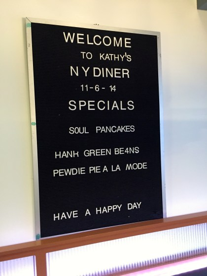 """The """"menu"""" in the kitchen, which also doubles as a diner set"""
