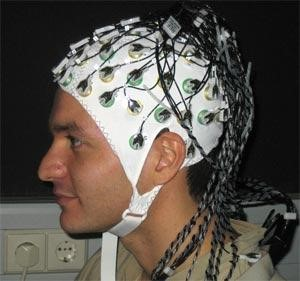 Someone wearing an EEG cap.