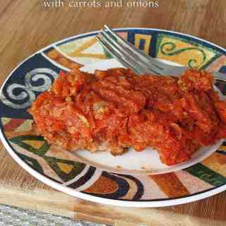 Fried Fish with Carrots, Onions and Parsnip in Tomato Sauce
